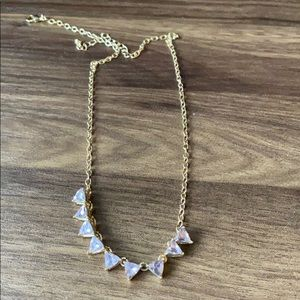 Cute gold necklace with purple tinted stones